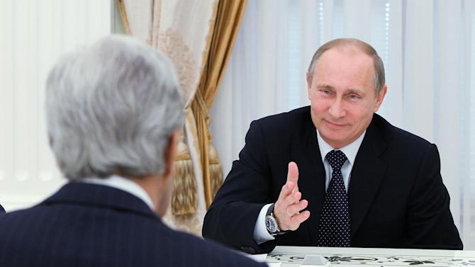 Russian President Vladimir Putin, right, speaks to U.S. Secretary of State John Kerry during their meeting in the Kremlin in Moscow, Tuesday, May 7, 2013. John Kerry is making his case to Russian President Vladimir Putin for Russia to take a tougher stance on Syria at a time when Israel's weekend air strikes against the beleaguered Mideast nation have added an unpredictable factor to the talks. (AP Photo/RIA-Novosti, Mikhail Klimentyev, Presidential Press Service)
