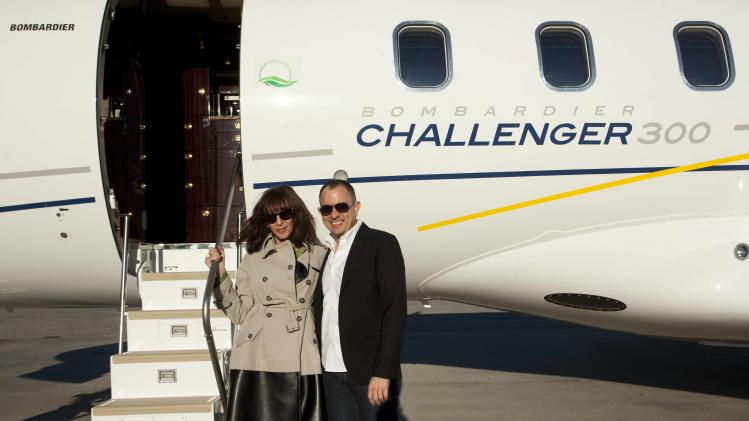IMAGE DISTRIBUTED FOR BOMBARDIER - Hollywood Reporter senior writer Merle Ginsberg and Hollywood Reporter Consumer Vice President Jonathan Aubry are seen at The Hollywood Reporter's Palm Springs Shuttle presented by Bombardier Business Aircraft - Day 1 on Friday, January 4, 2013 in Palm Springs, California.  (Photo by Adam Rose/Invision for Bombardier/AP Images)
