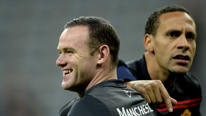 Wayne Rooney (left) and Rio Ferdinand warm up before Manchester United's Champions League quarter-final second leg game against Bayern Munich in Munich on April 9, 2014