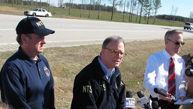 Robert Sumwalt, center, a board member of the National Transportation Safety Board, addresses reporters Thursday, Feb. 21, 2013, with NTSB investigator Ralph Hicks, left,  about the crash of a private jet in Thomson, Ga. Authorities say five people died and two were hospitalized after the plane aborted its landing and struck the top of a concrete utility pole. (AP Photo/Russ Btnum)