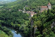 File photo shows the village of Saint-Cirq-Lapopie, perched on a rocky outcrop overlooking the Lot River in southwestern France. The mediaeval village has survived wars and invasions since the 13th century. Now, the picturesque hamlet is facing a new and potentially more dangerous threat: tourists