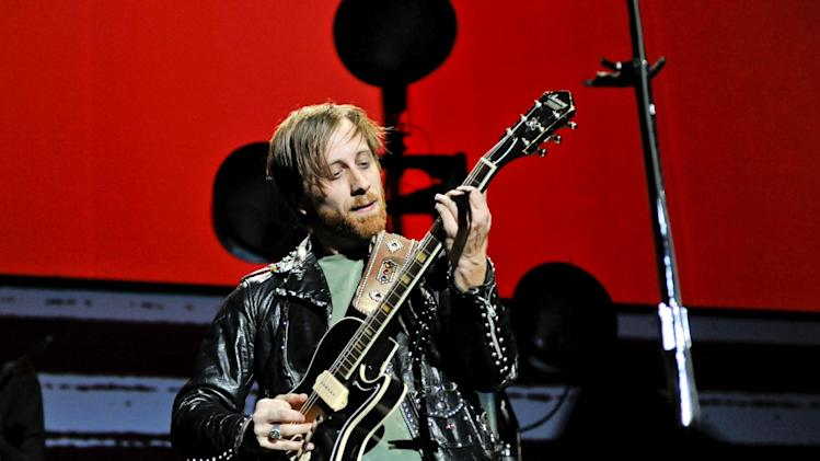 "FILE - In this March 12, 2012 file photo, guitarist/vocalist Dan Auerbach of The Black Keys performs at Madison Square Garden, in New York. The Black Keys sued Pizza Hut and Home Depot on June 22, 2012, in Los Angeles, claiming the corporations violated their copyrights by using elements of their songs ""Gold on the Ceiling"" and ""Lonely Boy"" in advertisements. (AP Photo/Evan Agostini, File)"