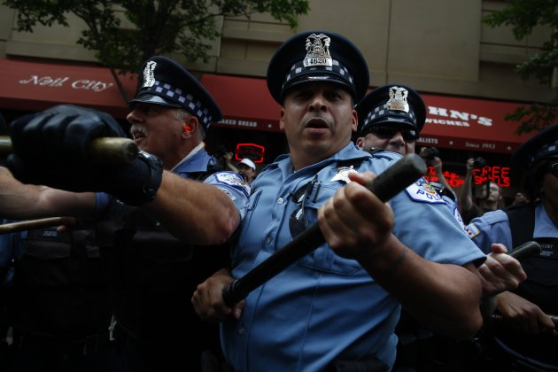 Demonstrators clash with police during an anti-NATO protest march in Chicago