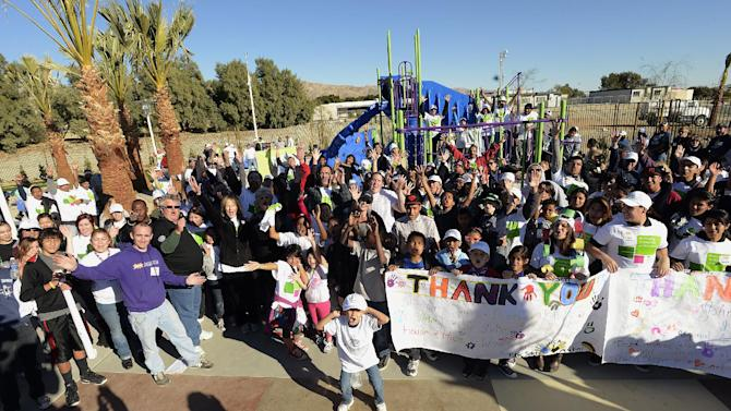 IMAGE DISTRIBUTED FOR HUMANA-Volunteers celebrate after building a one-of-kind, multi-generational playground at the Boys & Girls Clubs of Coachella Valley, on Saturday, Jan. 12, 2013, in Desert Hot Springs, Calif. Nearly 400 volunteers joined The Humana Foundation, the philanthropic arm of Humana, Inc., one of the nation's leading health care companies; KaBOOM!, a national non-profit organization that has built more 2,200 playgrounds; the Boys & Girls Clubs of Coachella Valley and the City of Desert Hot Springs to build the playground in just six hours. The playground build is one of many wellness-focused activities taking place leading up to the 2013 Humana Challenge PGA TOUR golf tournament, which will be held Jan. 14-20, 2013, in La Quinta, Calif. The build is a direct result of people who wore Humana pedometers and logged their steps during the 2012 Humana Challenge Walkit program, in which every step counted toward the donation made by the Humana Foundation (Gabriel Acosta / AP Images for Humana).