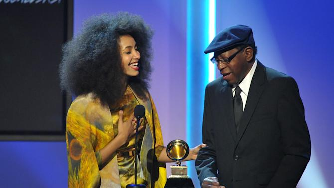 "Esperanza Spalding, left, and Thara Memory, right accept the award for instrumental arrangement with vocalists for ""City of Roses"" at the 55th annual Grammy Awards on Sunday, Feb. 10, 2013, in Los Angeles. (Photo by John Shearer/Invision/AP)"