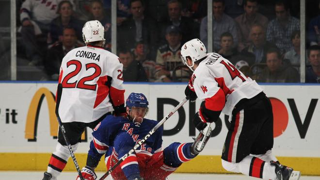 Marian Gaborik #10 Of The New York Rangers Falls To The Ice Against The Defense Of Erik Condra #22 And Chris Phillips Getty Images