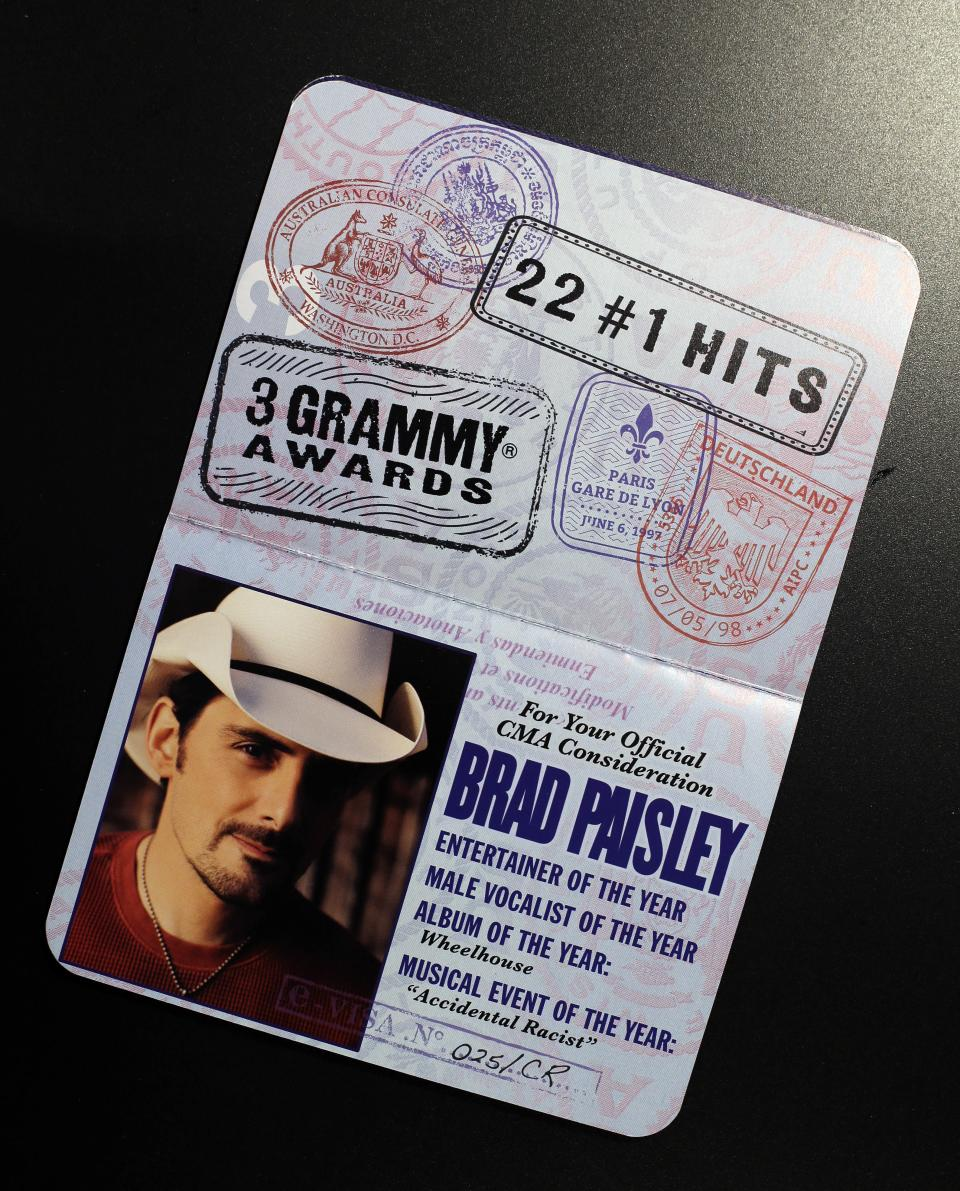 This Oct. 30, 2013 photo shows a Brad Paisley passport that was produced to influence voters of the CMA Awards in Nashville, Tenn. The CMA encourages artists and their labels to educate voters, allowing three email blasts and one mailed product a year. (AP Photo/Mark Humphrey)
