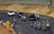 Villagers wave along the road as the funeral cortege carrying the coffin of former South African President Nelson Mandela drives through Mandela's homeland just outside the village of Qunu December 14, 2013. REUTERS/Kai Pfaffenbach