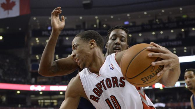 Toronto Raptors' DeMar DeRozan drives the ball against New Orleans Pelicans' Al-Farouq Aminu during first quarter NBA action in Toronto, Monday, Feb. 10, 2014