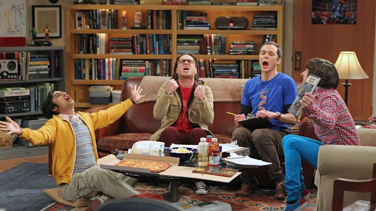 "This publicity image released by CBS shows, from left, Kunal Nayyar, Johnny Galecki, Jim Parsons and Simon Helberg in a scene from ""The Big Bang Theory."" Production on a new season of ""The Big Bang Theory"" is being delayed due to a contract dispute with its top actors. The Warner Brothers Television studio, which makes television's most popular comedy for CBS, said that Wednesday's scheduled first day of work after the summer hiatus has been postponed. The series is heading into its eighth season, and the studio is trying to hammer out new deals with actors Jim Parsons, Johnny Galecki, Kaley Cuoco, Simon Helberg and Kunal Nayyar. (AP Photo/CBS, Monty Brinton, FIle)"
