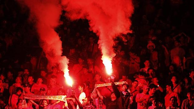 Supporters of Indonesia light flares during the team's 2015 Asian Cup qualifying match against Saudi Arabia in Jakarta (Reuters)