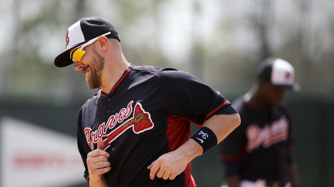 Atlanta Braves' John Buck runs through a drill during a spring training baseball workout, Monday, March 2, 2015, in Kissimmee, Fla. (AP Photo/David Goldman)