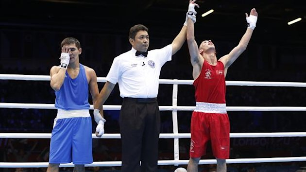 Ireland's John Joe Nevin (R) reacts after defeating Kazakhstan's Knat Abutalipov in their Men's Bantam (56kg) Round of 16 boxing match during the London 2012 (Reuters)