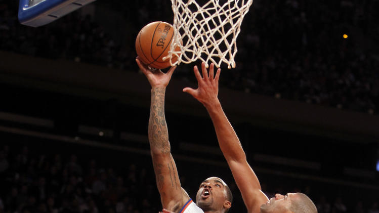 New York Knicks' J.R. Smith (8) shoots over Miami Heat's Shane Battier (31) during the first half of an NBA basketball game, Friday, Nov. 2, 2012, in New York. (AP Photo/Jason DeCrow)