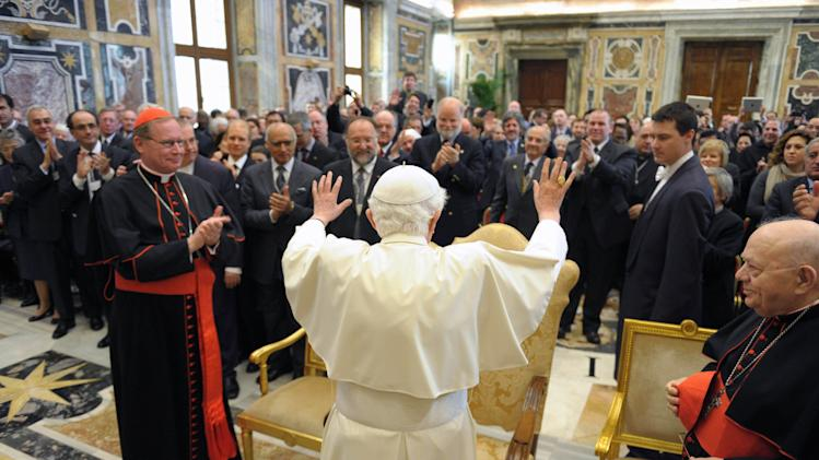 In this picture made available by the Vatican newspaper Osservatore Romano, Pope Benedict XVI greets the faithful of the Pontifical Academy for Life during a private audience at the Vatican, Saturday, Feb. 25, 2012. (AP Photo/Osservatore Romano, Handout)