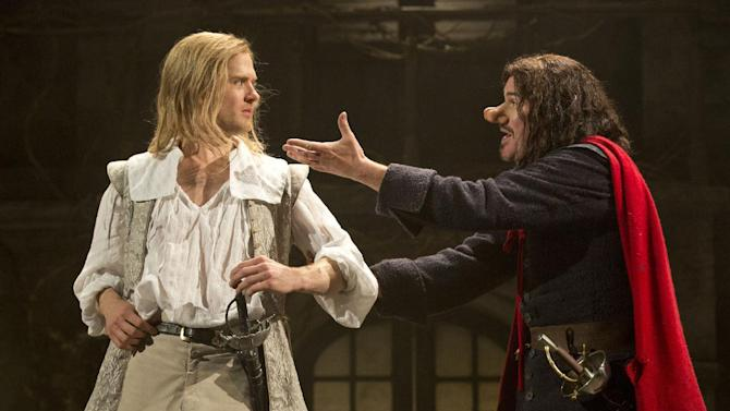 """This theater image released by Boneau-Bryan/Brown shows Kyle Soller, left, and Douglas Hodge portraying the title role in """"Cyrano de Bergerac,"""" playing at the American Airlines Theatre in New York. (AP Photo/Boneau-Bryan/Brown, Joan Marcus)"""