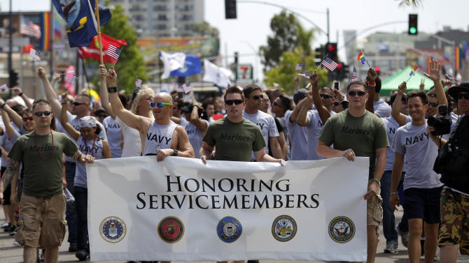 Members of the military march in the Gay Pride Parade Saturday, July 16, 2011, in San Diego. More than 200 active duty troops and war veterans waving small American flags alongside rainbow banners marched in San Diego's gay pride parade in what is believed to be the first time an identifiable group of active duty troops has participated in such an event in the U.S. (AP Photo/Gregory Bull)