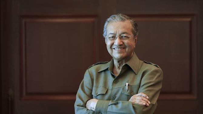 Former Malaysian prime minister Mahathir Mohamad poses for a picture after an interview at his office in Kuala Lumpur