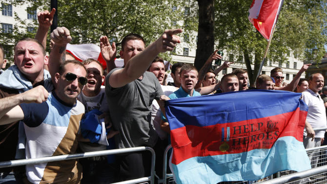English Defence League supporters protest outside Downing Street in London in support of the British armed forces, after the brutal killing of an off-duty British soldier in a London street last week, Monday, May 27, 2013. (AP Photo/Sang Tan)