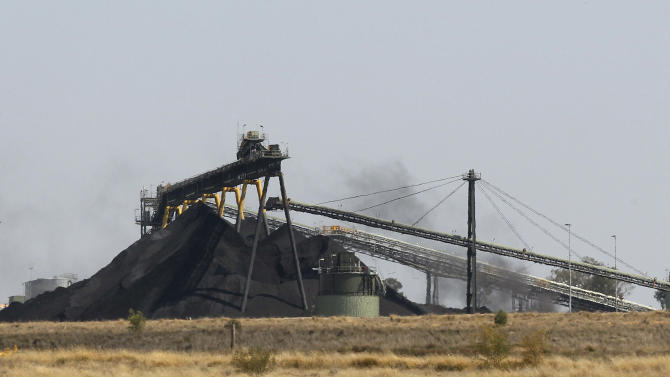 This Sept. 11, 2012 photo shows a Whitehaven Coal mine outside Narrabri, Australia near Gunnedah, 450 kilometers (280 miles) northwest of Sydney. Soaring coal prices fueled by China's economic growth have made mining parts of the Australian landscape far more lucrative than farming it. (AP Photo/Rob Griffith)