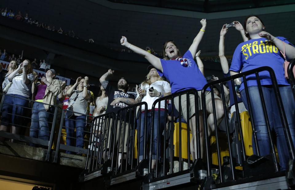 Concert goers react during the Boston Strong Concert: An Evening of Support and Celebration at the TD Garden on Thursday, May 30, 2013 in Boston. (Photo by Bizuayehu Tesfaye/Invision/AP)