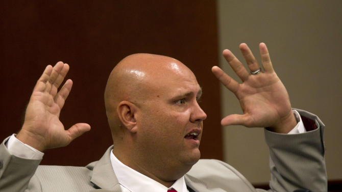 Paulding County sherriff's invistigator Kyle Shelton testifies in a courtroom during a hearing for Paul and Sheila Comer in Dallas, Ga., Thursday, Oct. 4, 2012. The Comers are accused of locking their teenaged son in a bedroom with little food for years. (AP (AP Photo/John Bazemore)