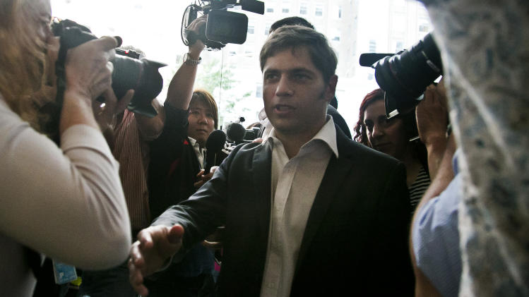 Axel Kicillof, Argentina's economy minister, arrives amid a crowd of reporters for negotiations, Wednesday July 30, 2014, in New York. Argentina officials and U.S. bondholders met for the first time in hopes of preventing an Argentine default. (AP Photo/Bebeto Matthews)