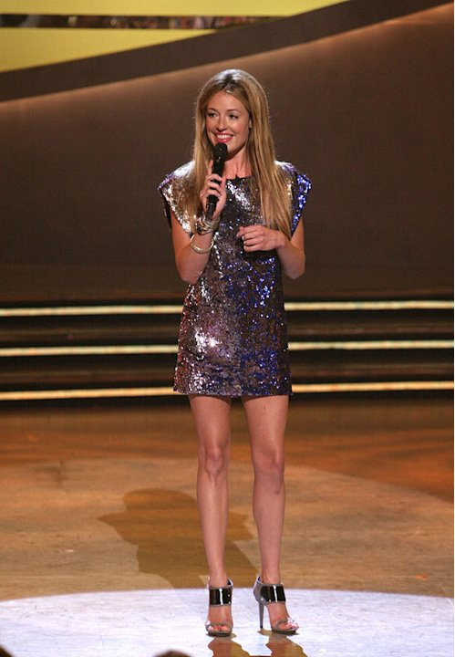 "When two of the final 10 dancers were cut on Season 5 of ""So You Think You Can Dance,"" Cat Deeley sparkled in a Matthew Williamson sequined sheath dress, a pair of futuristic Sergio Rossi heels, and v"