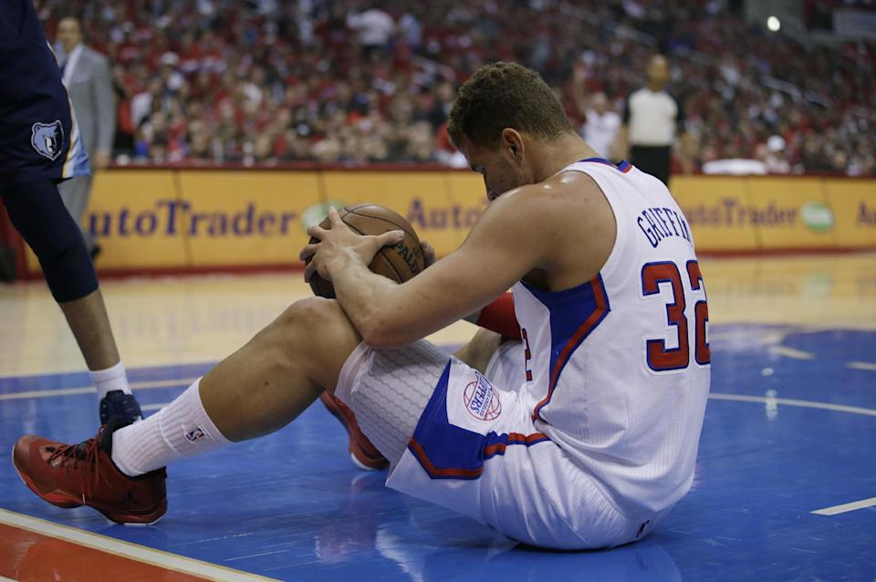 Los Angeles Clippers' Blake Griffin sits on the court during the first half in Game 5 of a first-round NBA basketball playoff series against the Memphis Grizzlies in Los Angeles, Tuesday, April 30, 2013. (AP Photo/Jae C. Hong)