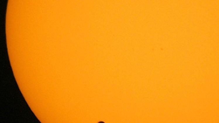 FILE - This June 8, 2004 file photo shows the transit of Venus, which occurs when the planet Venus passes between the Earth and the Sun, is pictured in Hong Kong. Venus will cross the face of the sun on Tuesday June 5, 2012, a sight that will be visible from parts of Earth. This is the last transit for more than 100 years. (AP Photo/Vincent Yu,File)