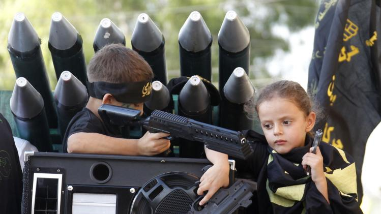"Palestinian children hold toy weapons, in solidarity with the Palestinians in Gaza, during a demonstration to mark ""Quds (Jerusalem) Day"" in the Ain al-Hilweh Palestinian refugee camp near the port-city of Sidon, southern Lebanon"