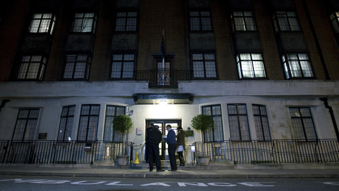 FILE - In this Monday, Dec. 3, 2012 file photo, policeman stand guard outside the King Edward VII hospital where the Duchess of Cambridge has been admitted with a severe form of morning sickness,  in London .King Edward VII hospital says the nurse involved in Kate hoax call has died, it has been announced, Friday, Dec. 7, 2012. (AP Photo/Alastair Grant, File)