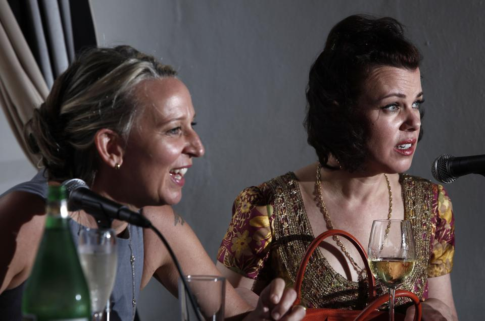 "Celebrity chef Gabrielle Hamilton, left, and actress/food blogger Debi Mazar, right, laugh during a panel discussion called ""Girls Gone Wild"" about women in the celebrity cooking world at the South Beach Wine and Food Festival, Saturday, Feb. 25, 2012 in Miami.  (AP Photo/Carlo Allegri)"