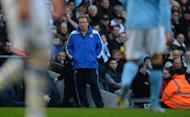 Leeds United&#39;s English manager Neil Warnock (C) looks on during the fifth round English FA Cup football match between Manchester City and Leeds United at the Etihad Stadium in Manchester on February 17, 2013. Leeds United&#39;s vociferous 6,000 travelling fans turned on Warnock during their side&#39;s 4-0 FA Cup humiliation at City - and the boss revealed he was ready to bow to pressure to stand down