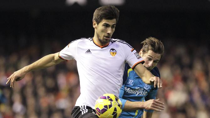 Valencia's Gomes and Sevilla's Krychowiak fight for the ball during their Spanish first division soccer match in Valencia