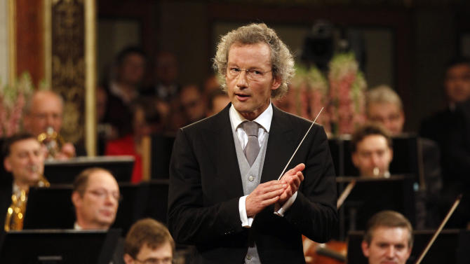 "FILE - The Jan 1, 2013 file photo shows Austrian maestro Franz Welser-Moest conducting the Vienna Philharmonic Orchestra during the traditional New Year's concert at the Golden Hall of the Musikverein in Vienna, Austria. Welser-Moest is quitting as music director of the Vienna State Opera with immediate effect, citing ""differences"" with opera director Dominique Meyer. Moest also says he will not conduct or participate in any of this year's productions, leaving one of the world's premier operas scrambling for replacements. In a letter made public Friday, Sept. 5, 2014 Moest said that ""differences over artistic issues were not solvable in several meetings."" (AP Photo/Ronald Zak, file)"