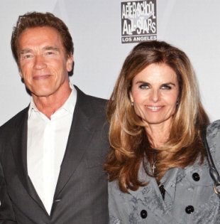 Arnold Schwarzenegger and Maria Shriver arrive at an event in February 2011. This week, the former governor revealed that he had an affair and fathered a child with a member of their household staff 10 years ago. (Photo: Chelsea Lauren)