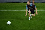 Iniesta takes part in a training session at the Olympic Stadium in Kiev, on the eve of the team's Euro 2012 football championships final match. Amid all the surprising criticism that they have attracted during Euro 2012, finalists Spain can at least reflect happily on the universal admiration shown for Iniesta