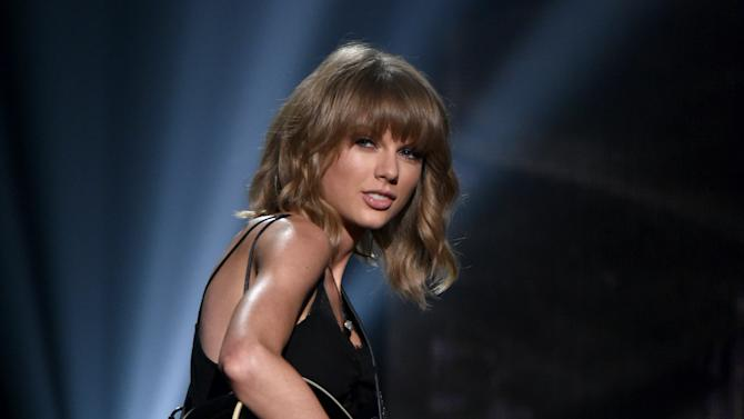 Taylor Swift performs on stage at the iHeartRadio Music Awards at The Shrine Auditorium on Sunday, March 29, 2015, in Los Angeles.  (Photo by John Shearer/Invision for iHeartRadio/AP Images)