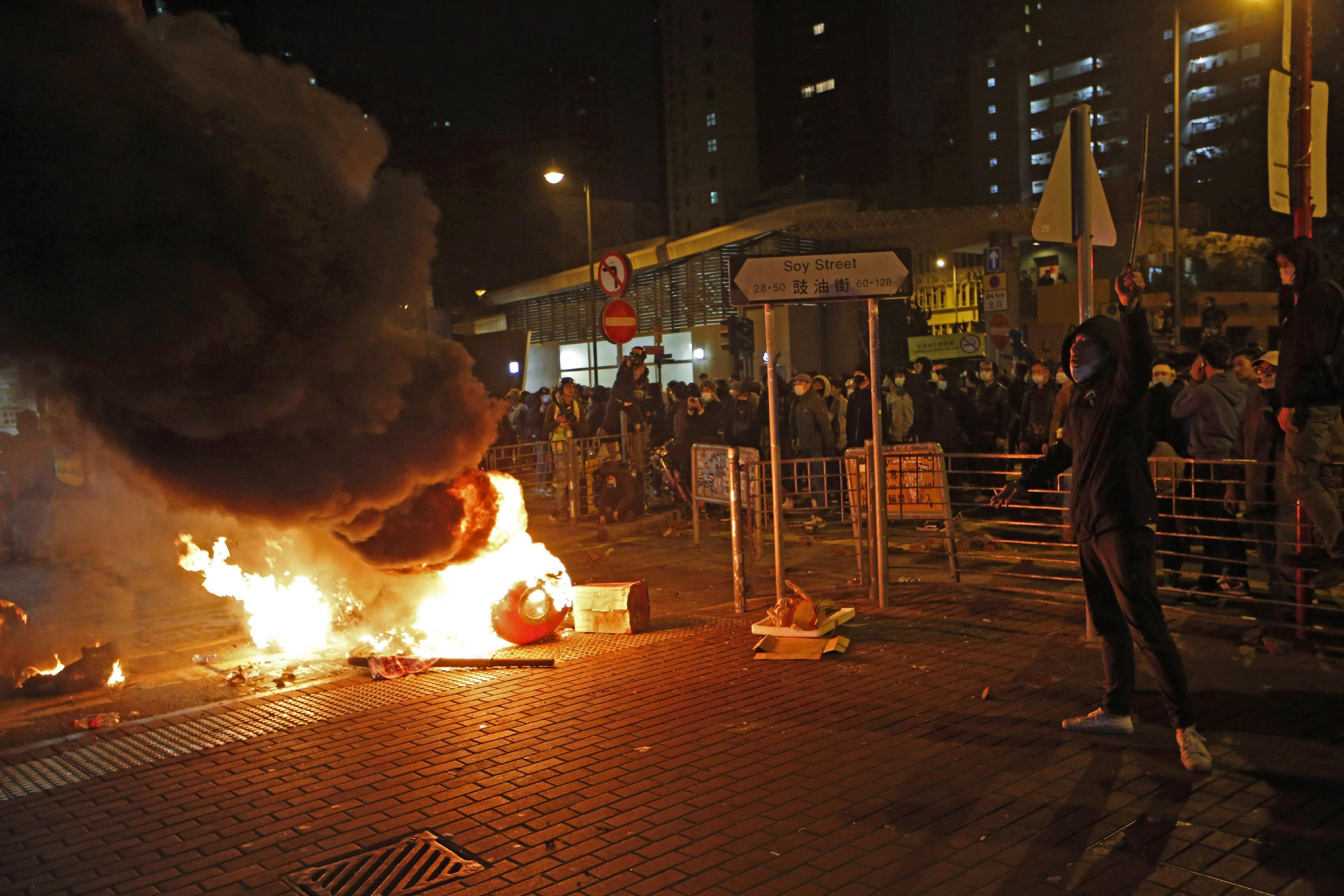 Hong Kong student held at airport after violent clashes