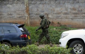 A Kenyan security forces soldier walks towards the …