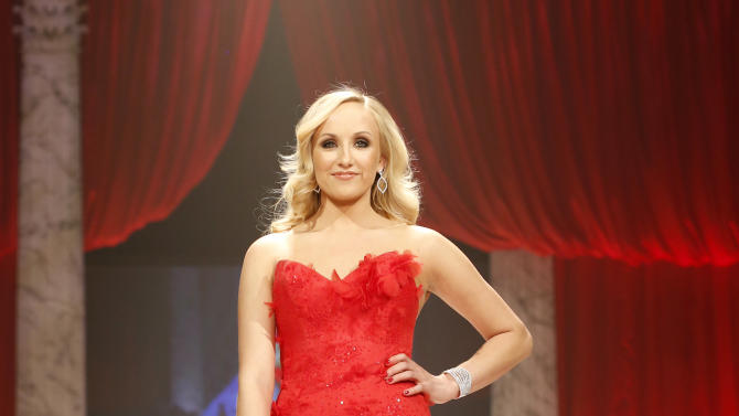 Nastia Liukin walks the runway at the Red Dress Collection 2013 Fashion Show, on Wednesday, Feb. 6, 2013 in New York. (Photo by John Minchillo/Invision/AP)