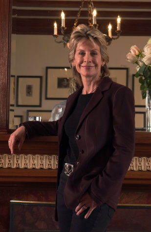 FILE - In this Oct. 27, 2005 file photo, author Patricia Cornwell poses in her home in New York. Cornwell is suing her former financial management company and business manager for negligence and breach of contract. She claims they cost her millions in investment losses and unaccounted-for revenues during their relationship. (AP Photo/Jim Cooper, File)