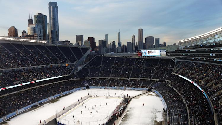 Minnesota plays Wisconsin in the second period of a college hockey game in the OfficeMax Hockey City Classic at Chicago's Soldier Field, Sunday, Feb. 17, 2013. (AP Photo/Charles Rex Arbogast)