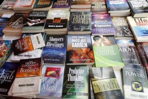 Books, many written by Bishop David Oyedepo, founder …