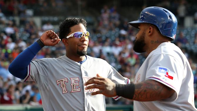 Texas Rangers Prince Fielder(R) celebrates with Elvis Andrus  after hitting a RBI single during the seventh inning of the Rangers baseball game against the Cleveland Indians Monday, May 25, 2015, in Cleveland. (AP Photo/Aaron Josefczyk)