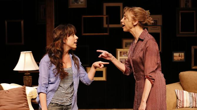 """This theater publicity image released by Richard Kornberg & Associates shows Leslie Kritzer, left, and Catherine Cox, in a scene from the Transport Group production of the musical, """"The Memory Show"""", currently performing off-Broadway at The Duke on 42nd Street in New York.  (AP Photo/Richard Kornberg & Associates, Carol Rosegg)"""
