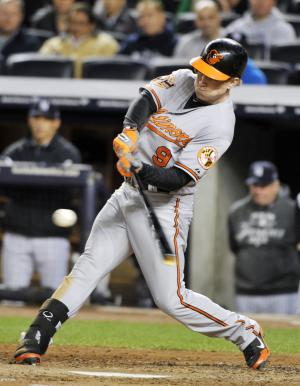 Baltimore Orioles' Nate McLouth hits a home run during the fifth inning of Game 4 of the American League division baseball series against the New York Yankees, Thursday, Oct. 11, 2012, in New York. (AP Photo/Bill Kostroun)