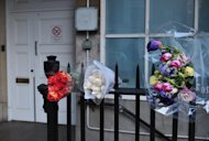 Flowers are left outside the nurses' accommodation block near King Edward VII hospital in London on December 9, 2012 in memory of ethnic Indian nurse Jacintha Saldanha who was found dead two days ago. The nurse at the hospital that treated Prince William's pregnant wife Catherine, was found dead on December 7, days after being duped by a hoax call from an Australian radio station