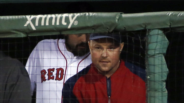 Boston Red Sox pitcher Jon Lester watches from the dugout during a baseball game against the Toronto Blue Jays at Fenway Park in Boston, Tuesday, July 29, 2014. (AP Photo/Elise Amendola)
